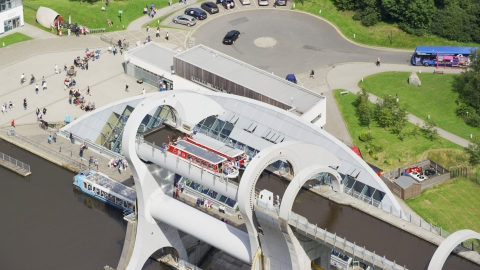 AX109_145.0000096F - Aerial stock photo of Two ferries on the Falkirk Wheel boat lift in Scotland