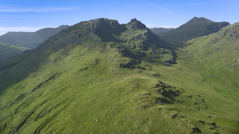 AX110_071.0000000F - Aerial stock photo of The Cobbler mountain peak in Scottish Highlands, Scotland, United Kingdom