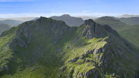 AX110_074.0000000F - Aerial stock photo of The Cobbler, a green mountain peak, Scottish Highlands, Scotland