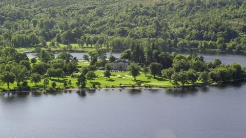 AX110_113.0000154F - Aerial stock photo of Rossdhu Mansion at Loch Lomond Golf Course, Luss, Scottish Highlands, Scotland