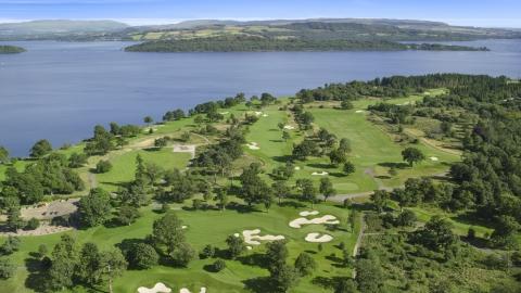 AX110_116.0000000F - Aerial stock photo of Loch Lomond Golf Course beside the water, Luss, Scottish Highlands, Scotland