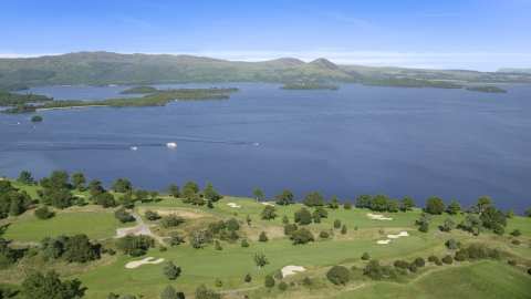 AX110_118.0000098F - Aerial stock photo of Waterfront Loch Lomond Golf Course in Luss, view of the lake, Scottish Highlands, Scotland