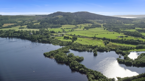 AX110_125.0000000F - Aerial stock photo of Farms beside Loch Lomond in Arden, Scottish Highlands, Scotland
