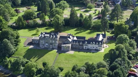 AX110_126.0000203F - Aerial stock photo of Lomond Castle in Arden, Scottish Highlands, Scotland