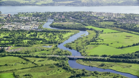 AX110_137.0000099F - Aerial stock photo of River Leven and waterfront town, Dumbarton, Scotland