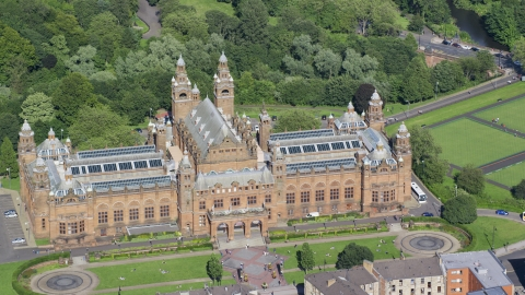 AX110_177.0000140F - Aerial stock photo of The Kelvingrove Art Gallery and Museum building in Glasgow, Scotland