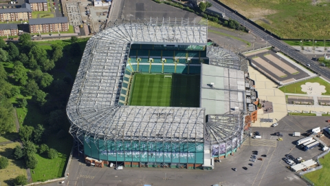 AX110_187.0000196F - Aerial stock photo of Celtic Park soccer stadium in Glasgow, Scotland