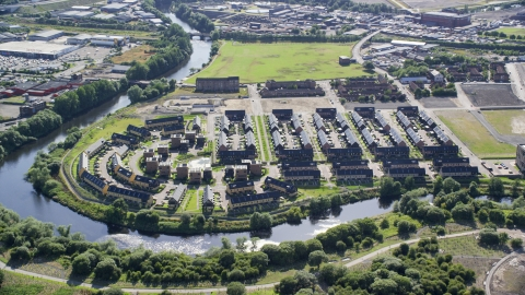 AX110_189.0000103F - Aerial stock photo of Riverfront row houses along River Clyde, Glasgow, Scotland