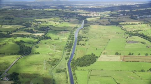 AX110_231.0000000F - Aerial stock photo of A river through farm fields in Cumbernauld, Scotland