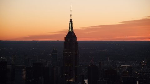 AX118_010.0000332F - Aerial stock photo of Sunrise at the Empire State Building in Midtown Manhattan, New York City