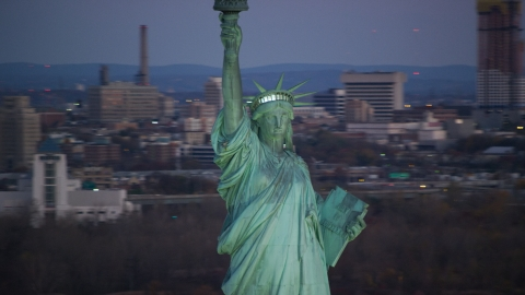 AX118_048.0000078F - Aerial stock photo of Front of the Statue of Liberty at sunrise, New York