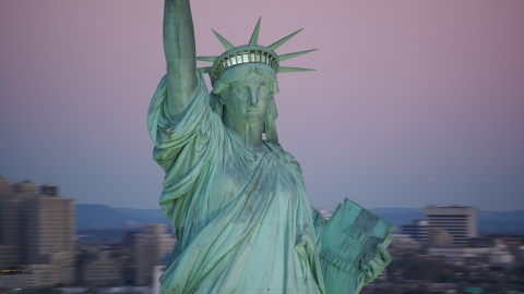 AX118_059.0000012F - Aerial stock photo of The Statue of Liberty at sunrise, New York