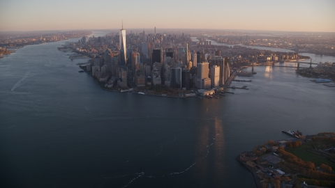AX118_085.0000000F - Aerial stock photo of Lower Manhattan at sunrise, New York City