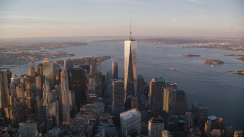 AX118_096.0000000F - Aerial stock photo of Freedom Tower at sunrise in Lower Manhattan, New York City