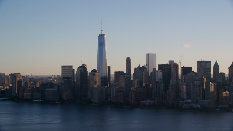 AX118_150.0000000F - Aerial stock photo of The Lower Manhattan skyline across the Hudson River at sunrise in New York City
