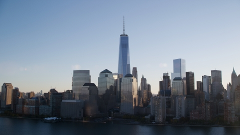 AX118_154.0000043F - Aerial stock photo of The World Trade Center skyline at sunrise in New York City