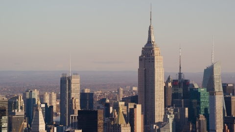 AX118_174.0000088F - Aerial stock photo of The Empire State Building in Midtown Manhattan at sunrise in New York City
