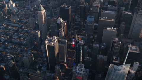 AX118_184.0000138F - Aerial stock photo of Times Square at sunrise in Midtown Manhattan, New York City