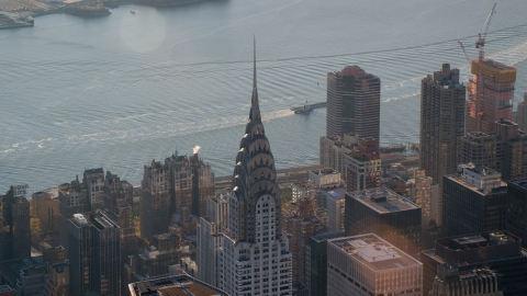 AX118_202.0000118F - Aerial stock photo of The Chrysler Building at sunrise in New York City