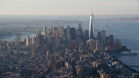 AX118_206.0000000F - Aerial stock photo of Freedom Tower and Lower Manhattan at sunrise in New York City