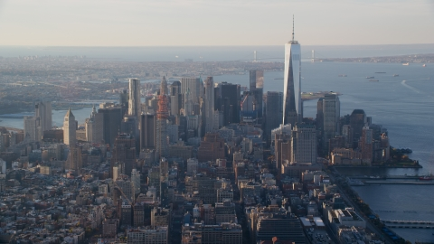 AX118_207.0000107F - Aerial stock photo of Lower Manhattan and One World Trade Center at sunrise in New York City