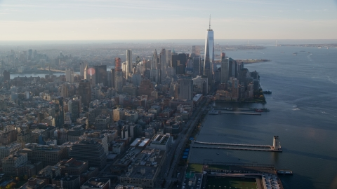 AX118_210.0000091F - Aerial stock photo of Pier 34 and Lower Manhattan at sunrise in New York City