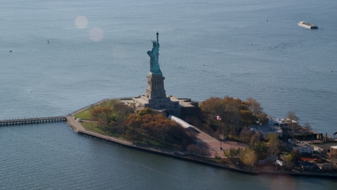 AX119_013.0000083F - Aerial stock photo of The back of Liberty Island and the Statue of Liberty in Autumn, New York