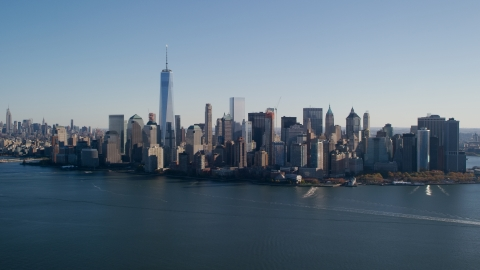 AX119_014.0000094F - Aerial stock photo of Skyline of Lower Manhattan across the Hudson River in New York City