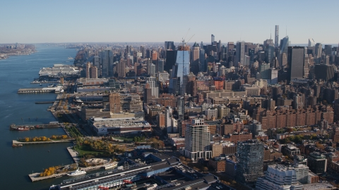 AX119_024.0000104F - Aerial stock photo of Chelsea Piers and riverfront buildings, Hudson Yards, and Midtown skyscrapers in New York City