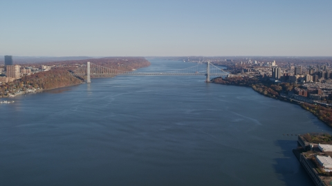 AX119_040.0000092F - Aerial stock photo of George Washington Bridge spanning the Hudson River in Autumn, New York City