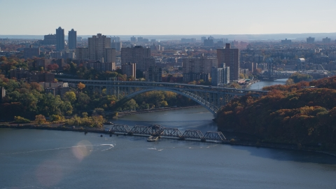 AX119_055.0000161F - Aerial stock photo of The Henry Hudson and Spuyten Duyvil Bridges in Autumn in The Bronx, New York City