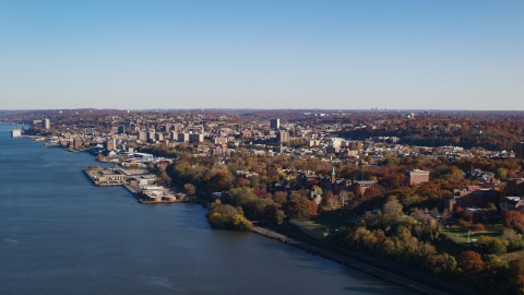 AX119_060.0000150F - Aerial stock photo of Yonkers by the Hudson River in New York in Autumn