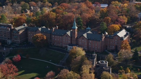 AX119_061.0000237F - Aerial stock photo of College of Mount Saint Vincent campus building in Autumn, Yonkers, New York