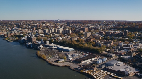 AX119_063.0000143F - Aerial stock photo of Riverfront warehouse buildings near downtown Yonkers, New York in Autumn