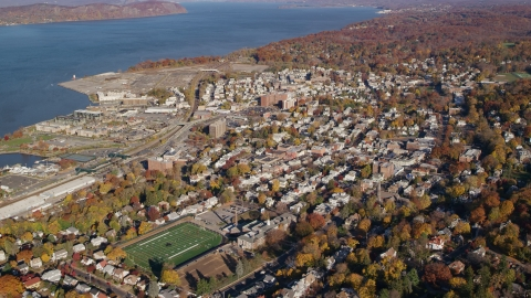 AX119_088.0000132F - Aerial stock photo of Riverfront towns of Tarrytown and Sleepy Hollow in Autumn, New York