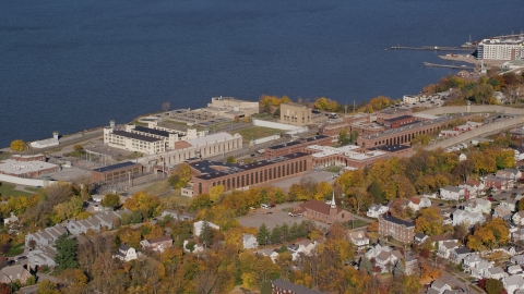 AX119_113.0000141F - Aerial stock photo of Sing Sing Prison in Autumn, Ossining, New York