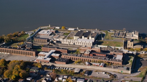 AX119_115.0000260F - Aerial stock photo of Riverfront Sing Sing Prison in Autumn, Ossining, New York