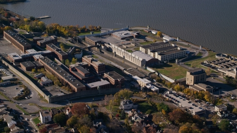 AX119_117.0000186F - Aerial stock photo of North side of Sing Sing Correctional Facility in Autumn, Ossining, New York