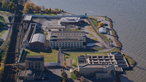 AX119_118.0000191F - Aerial stock photo of Sing Sing Correctional Facility complex in Autumn, Ossining, New York