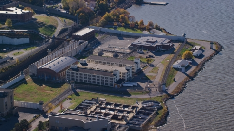 AX119_119.0000171F - Aerial stock photo of Sing Sing Prison complex in Autumn, Ossining, New York