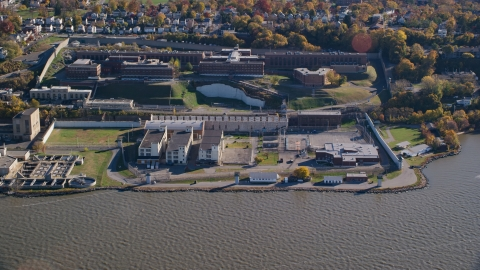 AX119_121.0000225F - Aerial stock photo of The Sing Sing Prison facility in Autumn, Ossining, New York