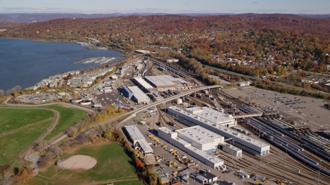 AX119_129.0000094F - Aerial stock photo of Riverfront rail station in Autumn, Croton on Hudson, New York
