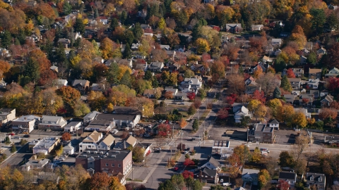 AX119_130.0000102F - Aerial stock photo of Small town homes around a street intersection in Autumn, Croton on Hudson, New York