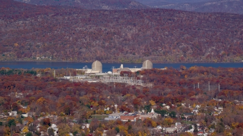 AX119_137.0000197F - Aerial stock photo of Indian Point Nuclear Power Plant in Autumn, Buchanan, New York