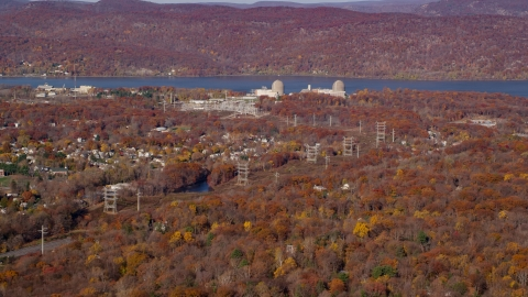 AX119_140.0000251F - Aerial stock photo of Indian Point Energy Center in Autumn, Buchanan, New York