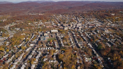AX119_145.0000103F - Aerial stock photo of Small town residential neighborhoods in Autumn, Peekskill, New York
