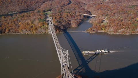 AX119_153.0000270F - Aerial stock photo of Oil tanker near Bear Mountain Bridge in Autumn, Westchester County, New York
