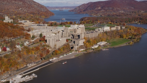 AX119_164.0000000F - Aerial stock photo of West Point Military Academy in Autumn, West Point, New York