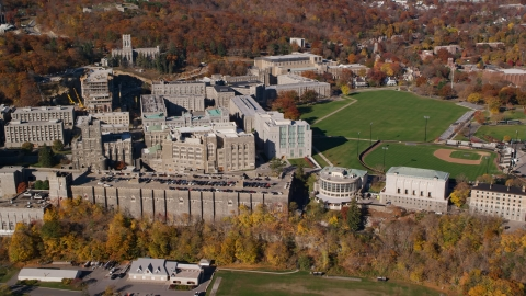 AX119_166.0000090F - Aerial stock photo of United States Military Academy in Autumn, West Point, New York