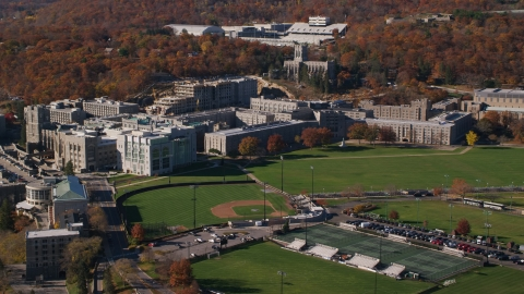 AX119_168.0000071F - Aerial stock photo of West Point Military Academy, The Plain, and baseball field in Autumn in New York